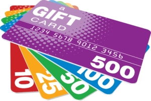 Four brightly colored cards with different denominations representing a gift card and loyalty program.