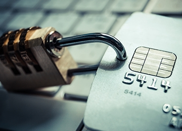 A combination lock attached to a chip credit card reflecting PCI DSS 3.2 security update